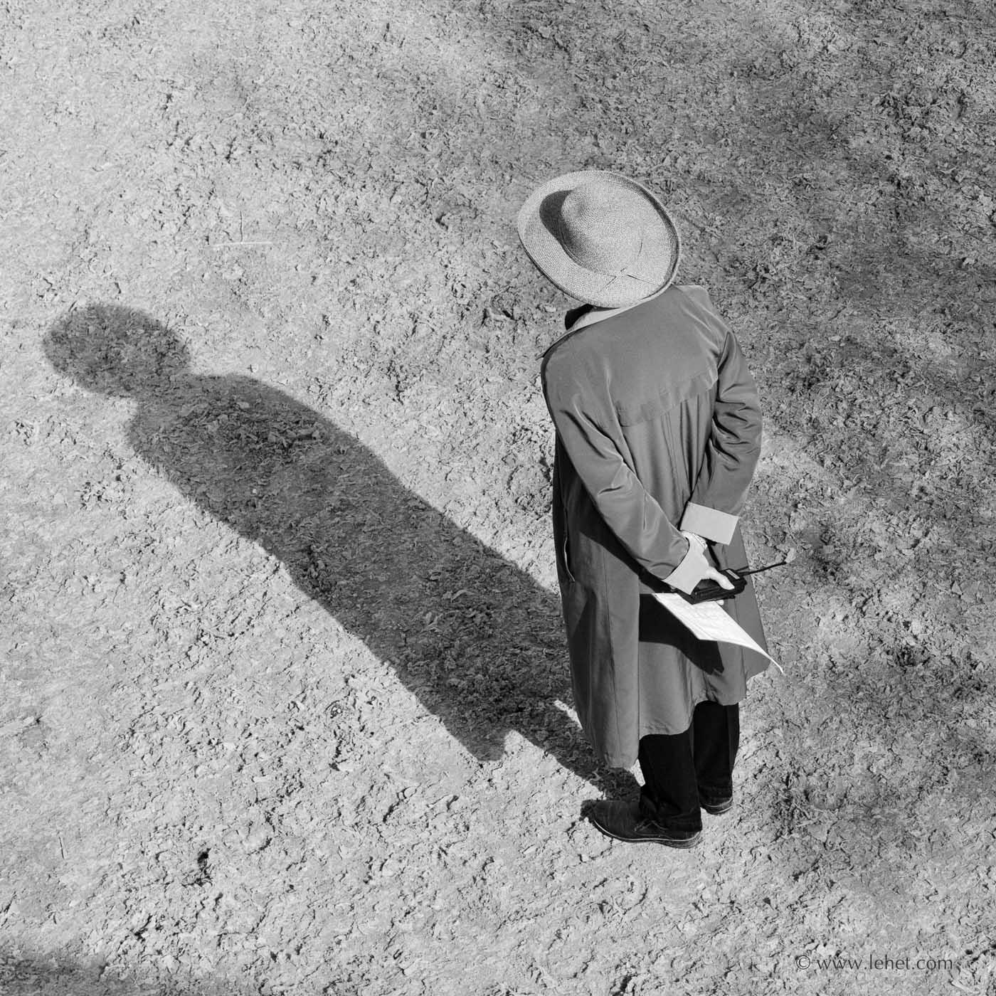 woman in straw hat with walkie talkie
