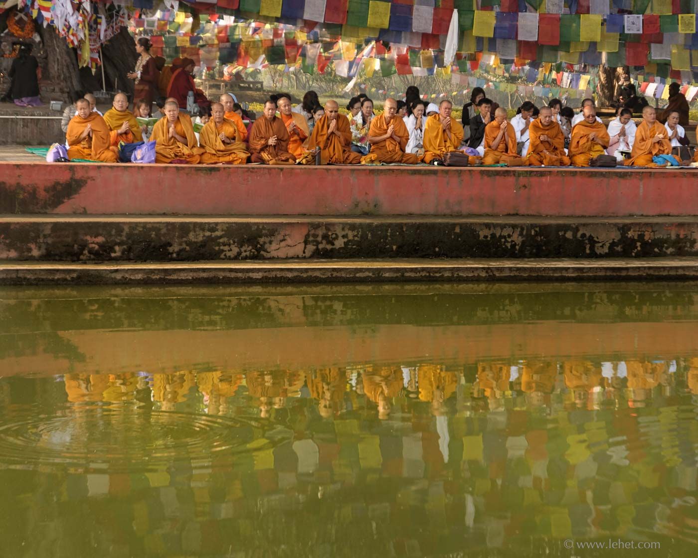 Theravada Monks Reflected in Pool Lumbini Nepal