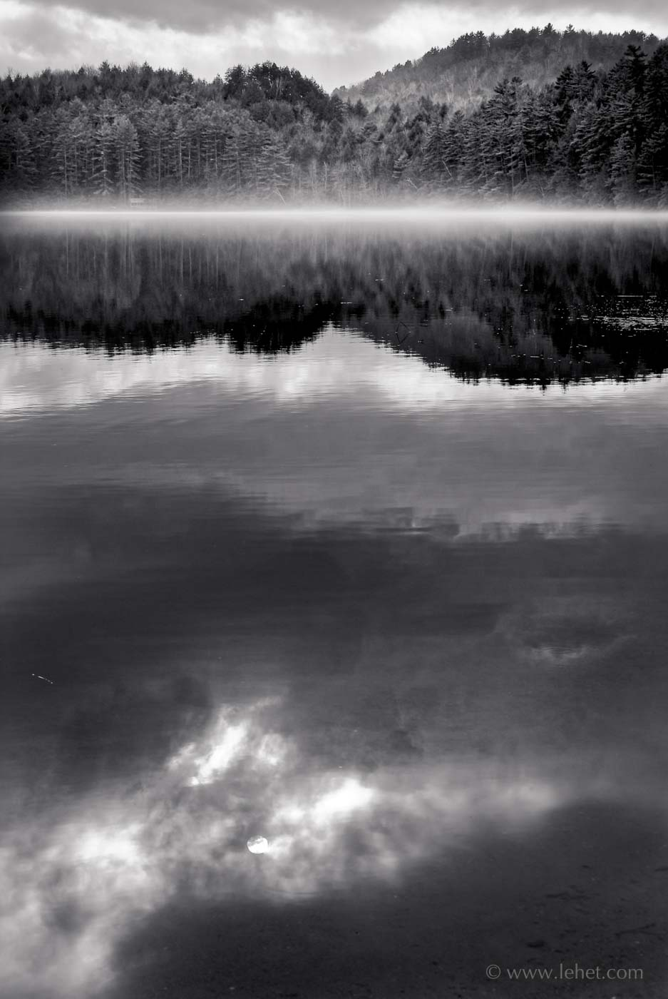 post pond misty waterline, cloud reflections and hills, black and white