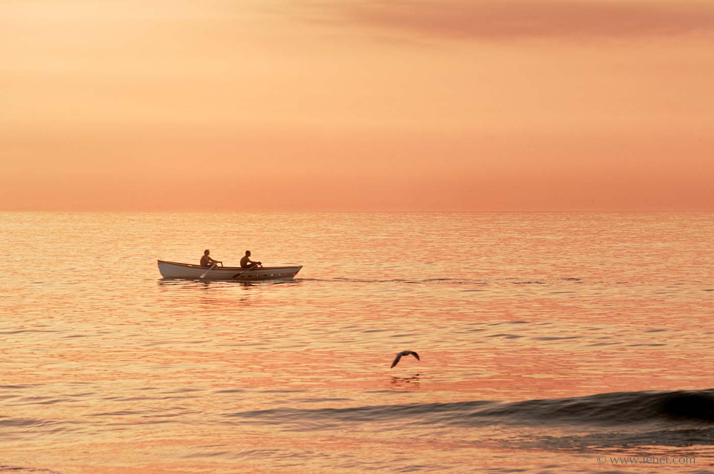 two lifeguards in a boat at dawn nj