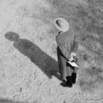 woman in straw hat with walkie talkie