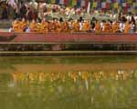Theravada Monks Reflected in Pool, Chanting at Buddha's Birthplace, Lumbini Nepal 2013